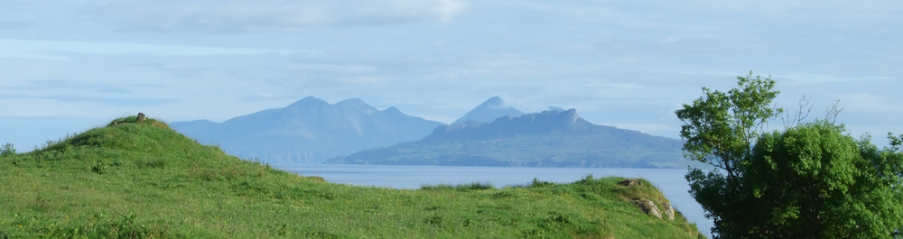 Islands of Eigg, Rhum & Muck from Self catering holiday house Ardnamurchan Scotland