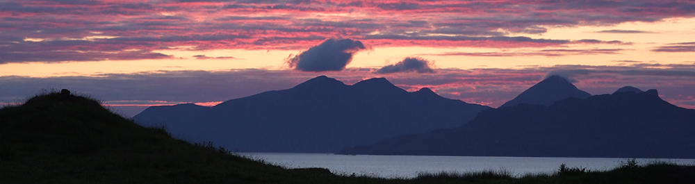 Sunset showing Islands of Eigg, Rhum & Muck from Self catering holiday house Ardnamurchan Scotland