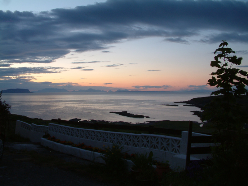 View over Islands Rhum Eigg Muck & Skye from garden at Air an Oir Ardnamurchan Scotland